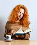Woman with book and tea cup Royalty Free Stock Images