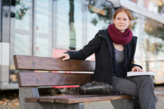 Woman with a Book Waiting on a Bench Royalty Free Stock Images