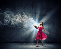 Woman with book Royalty Free Stock Images