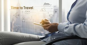 Woman booking a vacation using her smartphone stock image