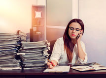 Woman bookkeeper using mobile phone at workplace Royalty Free Stock Photo