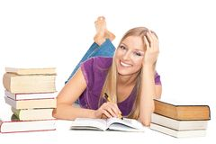 Woman with books. Smiling caucasian woman on the floor with books, learning Royalty Free Stock Photos