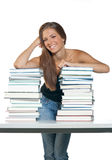 Woman with books. Attractive woman with pile of books royalty free stock photos