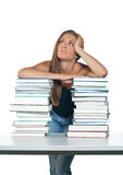 Woman with books. Woman leaning on pile of books and thinking royalty free stock images