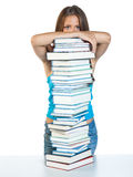 Woman with books. Woman hiding behind tower of books stock images