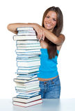 Woman with books. Attractive happy girl with pile of books royalty free stock image