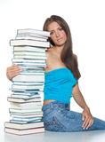 Woman with books. Attractive woman with pile of books stock image