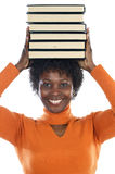 Woman with books. African american woman with books on her head Royalty Free Stock Photos