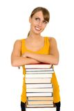 Woman with books. Woman leaning on stack of books Royalty Free Stock Photos