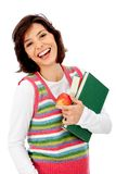 Woman with books and an apple Stock Photo