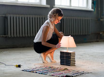 Woman with books and bright light bulb Royalty Free Stock Image