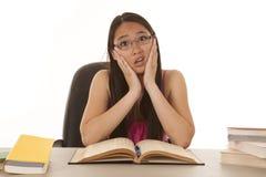 Woman books discouraged Stock Photo