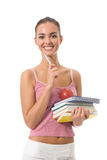Woman with books, isolated on white. Young woman with books, notebook and apple, isolated Royalty Free Stock Images