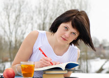 Woman with books and tea Royalty Free Stock Photography