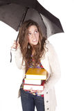 Woman with books under umbrella Royalty Free Stock Photo