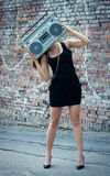 Woman with boom box face Stock Image
