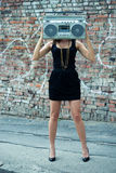 Woman with boom box head Royalty Free Stock Images
