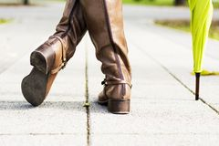 Woman boots casual in park Stock Photo