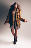 Woman in boots and fur coat Royalty Free Stock Photos