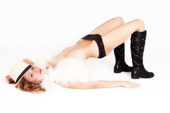 Woman in boots and fur vest Royalty Free Stock Photography