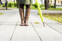 Woman boots in park Royalty Free Stock Image