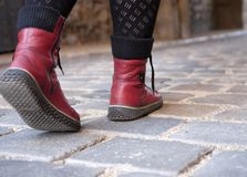 Woman boots on pavement Royalty Free Stock Image