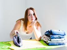 Woman bored of doing the ironing. Stock Photo