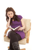 Woman bored reading purple Royalty Free Stock Image