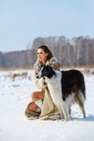 Woman with borzoi outdoors Stock Photo