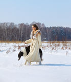 Woman with borzoi outdoors Stock Photos