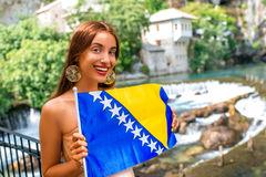 Woman with Bosnian flag in Blagaj village Royalty Free Stock Photography