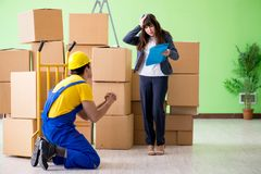 The woman boss and man contractor working with boxes delivery royalty free stock image