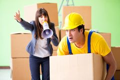 The woman boss and man contractor working with boxes delivery stock photography