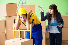 The woman boss and man contractor working with boxes delivery royalty free stock photography