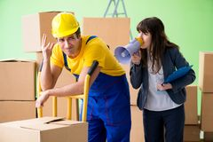The woman boss and man contractor working with boxes delivery. Woman boss and man contractor working with boxes delivery stock image