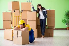 The woman boss and man contractor working with boxes delivery royalty free stock photos