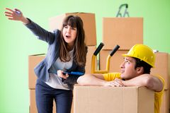 The woman boss and man contractor working with boxes delivery stock images