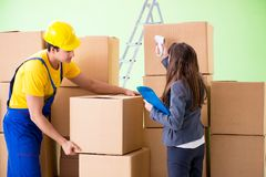 The woman boss and man contractor working with boxes delivery stock photos