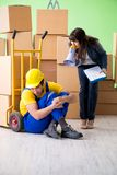 The woman boss and man contractor working with boxes delivery stock photo