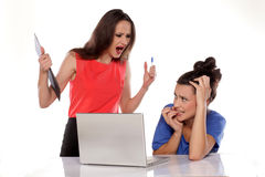 Woman boss. Shouting at her frightened employee Royalty Free Stock Images