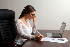 Woman boss works in the office Stock Image