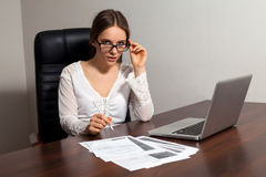 Woman boss works in the office Stock Images