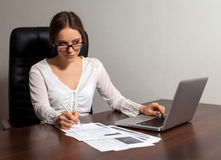 Woman boss works in the office Royalty Free Stock Image