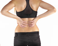 Woman with both palm around back to show pain and injury on back Royalty Free Stock Photography