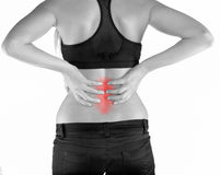 Woman with both palm around back to show pain and injury on back Royalty Free Stock Images