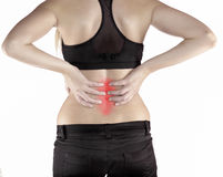 Woman with both palm around back to show pain and injury on back Stock Photo