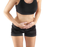 Woman with both palm around waistline to show pain on belly area Royalty Free Stock Images