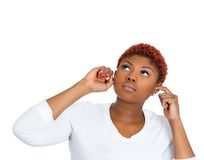 Woman bothered by loud noise Royalty Free Stock Image