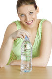 Woman with bottle. Portrait of woman with bottle of  water Stock Images