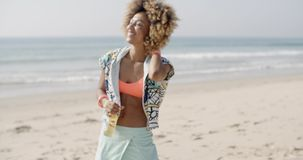 Woman With Bottle Against Sand Beach stock video